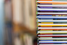 A Stack Of Colorful Books Clos...