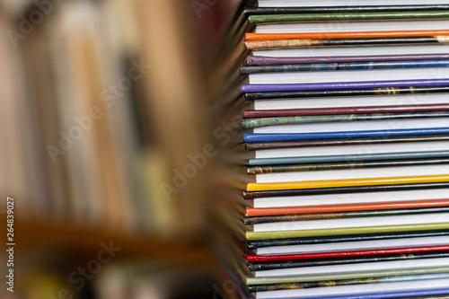 Obraz na plátně  A stack of colorful books close up