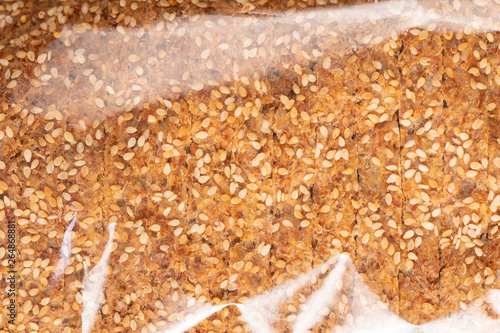 фотография Sprouted Grains Bread Texture in Plastic Wrap