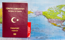 Turkish Passport And Turkish Airlines Ticket On The World Map.