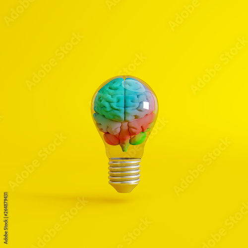 Fototapeta Colorful brain with a lightbulb on yellow background. Creative idea concept. 3d rendering obraz