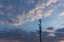 Wind Speed Sensor Or Anemometer With Blue Sky And Orange Light In Evening