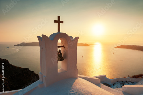 Foto auf AluDibond Cappuccino Traditional greek church at sunset on Santorini island, Greece
