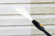 canvas print picture - Cleaning service washing building facade with pressure water. Cleaning dirty wall with high pressure water jet. Power washing the wall. Cleaning the facade of the house. Before and after washing