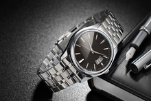 Steel Wristwatch On Black Back...
