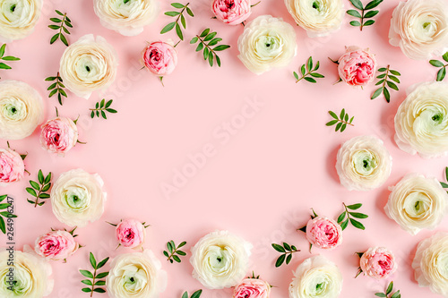 Printed kitchen splashbacks Floral Floral background frame made of pink ranunculus and roses flower buds on pink background. Flat lay, top view floral background.