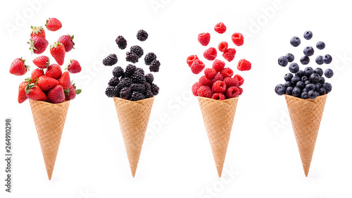 Fotografie, Obraz  In the foreground, lively variety of berries in ice cream cones, isolated from t