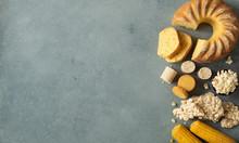 Festa Junina Traditional Food Background,copy Space For Text. Delicious Sweets For Brazilian Festa Junina Party: Cornmeal Cake Bolo De Fuba, Corn Cookies,popcorn,peanut Candy Pacoca, Corn Ear Top View