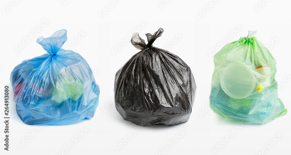 Three full garbage bags in row