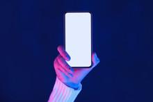 Woman's Hand Showing Smartphone Screen In Neon Lights