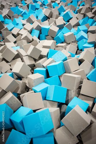 Gray and blue foam cubes on the playground in the trampoline center