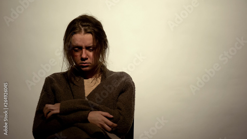 Photo Drug addicted woman suffering withdrawal symptoms undergoing rehabilitation