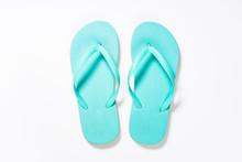 Blue Flip Flops On White Background.