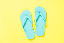 Blue Flip Flops On Yellow Back...