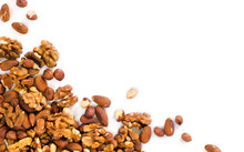 Background Of Mixed Nuts - Hazelnuts, Walnuts, Almonds - With Copy Space. Nuts Isolated One Edge. Assortment Nuts Top View Or Flat Lay