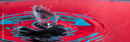 close up of a colorful water drop splash impact