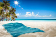 canvas print picture - Summer towel on sand and beach background.