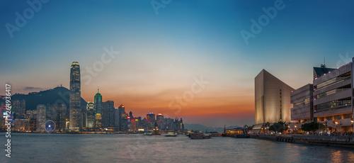 Fotografering  Victoria Harbor of Hong Kong city at dusk