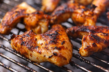 Chicken Wings On Barbecue, BBQ Grill With Fire.