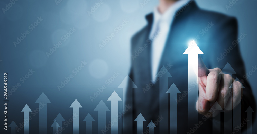 Fototapeta Business development to success and growing growth concept. Businessman pointing arrow graph corporate future growth plan and increase percentage