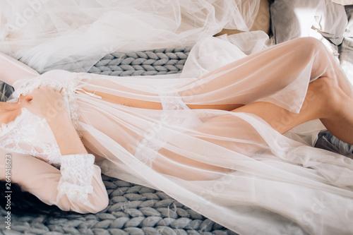 Boudoir portrait of beautiful bride. Bride wedding morning.