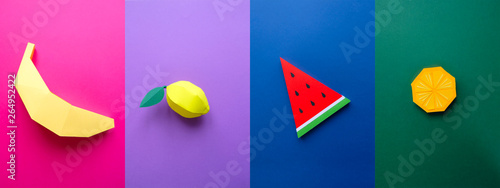 Fotografie, Obraz  Fruit made of paper. Colorful background. Tropics. Flat lay.