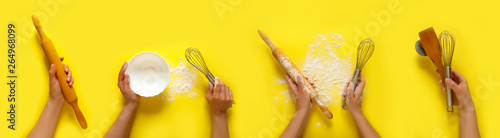 Photo  Female hands holding kitchen tools, sieve, rolling pin, bowl, sieve, brush, whisk,  cooking over yellow background