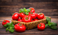 Fresh Ripe Tomatoes And Basil In The Basket