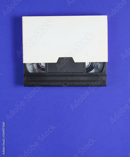 The videotape in a paper case on blue background Canvas-taulu