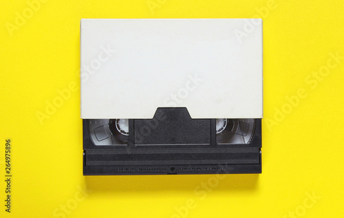 Obraz na plátně The videotape in a paper case on on yellow background