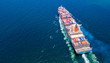 Leinwandbild Motiv Cargo ships with full container receipts to import and export products worldwide