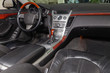 View to the black color interior of suv car with front seats, steering wheel and dashboard with gray leather upholstery after cleaning and detailing in vehicle repair workshop. Auto service industry.