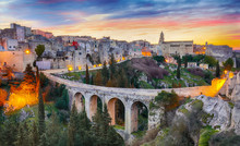 Gravina In Puglia Ancient Town, Bridge And Canyon At Sunrise. Panoramic View Of Old City Gravina In Puglia, Apulia, Italy. Europe