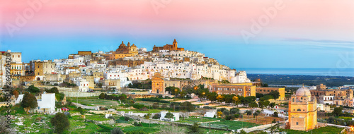 Foto auf Gartenposter Rosa hell Ostuni white town skyline and Madonna della Grata church