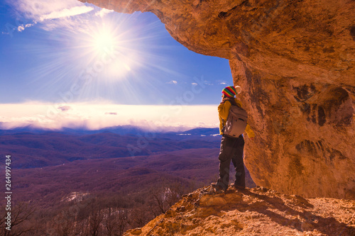 A woman in mainsails and caves, sunset Wallpaper Mural