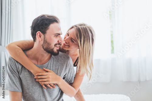 Happy couple lover on bed, hug and kiss in romantic time, love and passionate concept Wallpaper Mural