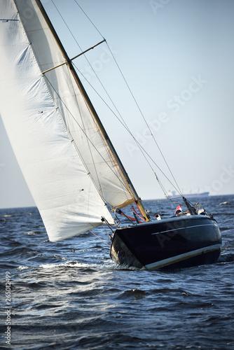 Blue yacht sails on a clear sunny day. Close-up. Baltic sea, Latvia
