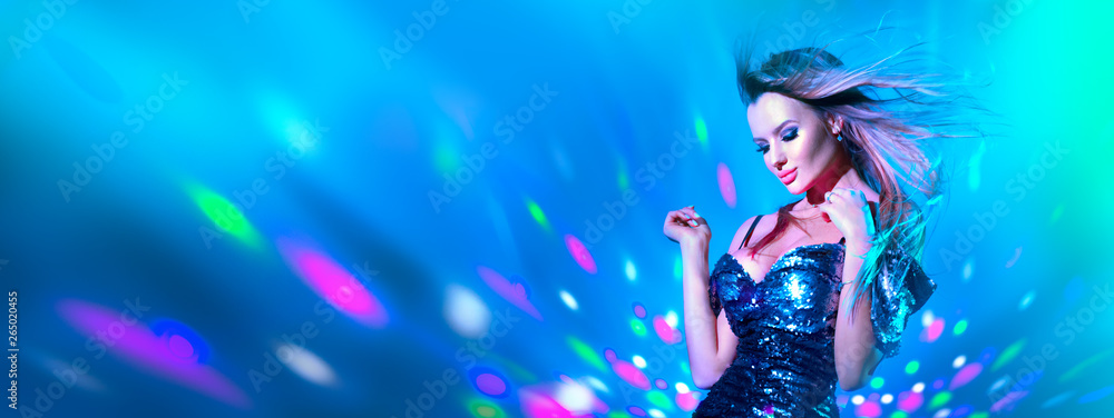 Fototapeta Fashion model sexy woman dancing in neon light. Disco dancer posing in UV colorful lights
