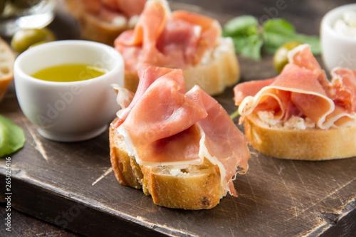 Valokuvatapetti Toast with serrano ham (jamon, prosciutto crudo, hamon), traditional Italian antipasti