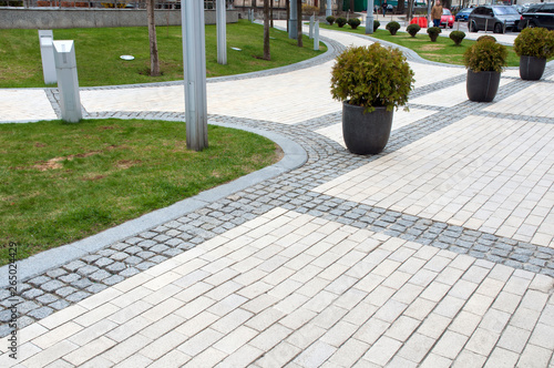 Poster Taupe railing and pavement in recreation areas and near architectural buildings