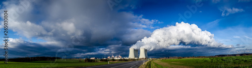 Nuclear plant and its cooling towers releasing a huge cloud of steam to the sky Wallpaper Mural