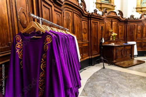 Obraz na plátne  Bari, Italy - March 10, 2019: Sacristy of the Basilica of San Sabino in Bari, with the liturgical robes and stoles of the priests on a coat rack