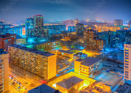 Poster Lieu connus d Asie Beautiful top view of the city. Colorful street lighting of the night metropolis. Many high-rise buildings. Cold winter weather. There is snow on the roofs of houses. Novosibirsk, Siberia, Russia.