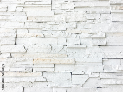 Photo sur Toile Brick wall Seamless texture of white decorative stacked stone, natural stone cladding