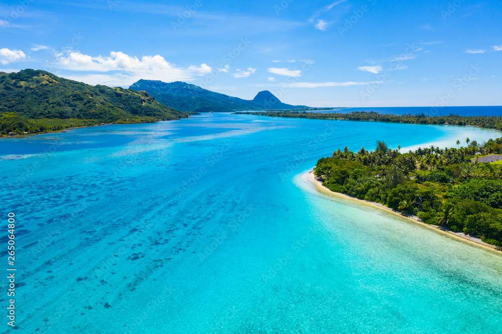 Fototapeta Aerial drone view of French Polynesia Tahiti island Huahine and Motu coral reef lagoon and Pacific Ocean. Tropical paradise.