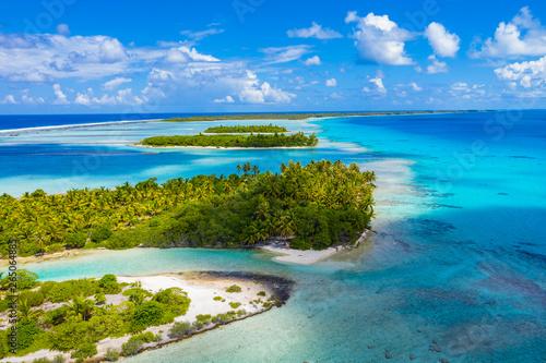 Fototapeta Drone aerial video of Rangiroa atoll island motu and coral reef in French Polynesia, Tahiti