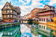 Leinwanddruck Bild - Traditional half-timbered houses on the canals district La Petite France in Strasbourg, UNESCO World Heritage Site, Alsace, France