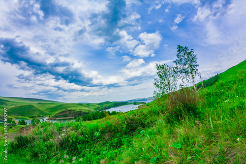 Fotografie, Obraz  Landscape with mountains and clouds through a fisheye lens