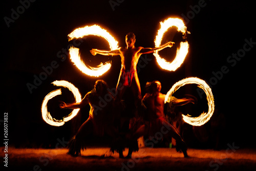 Luau Hawaii, French Polynesia fire dance silhouettes of professional dancers at night on beach resort tiki party Canvas Print