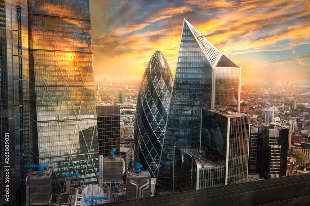 Fototapety, obrazy: City of London, UK. Skyline view of the famous financial bank district of London at golden sunset hour. View includes skyscrapers, office buildings and beautiful sky.